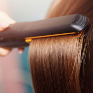 What is the most effective way to use hair straighteners